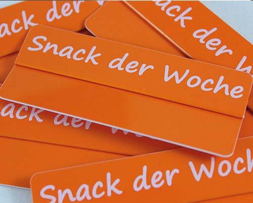 """Aktionsreiter, 86 x 18 mm, """"Snack der Woche"""", 10 Stück pro Pack"""